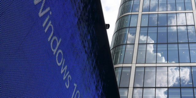 An advertisement for Windows 10 is seen in London's Canary Wharf financial district July 29, 2015.