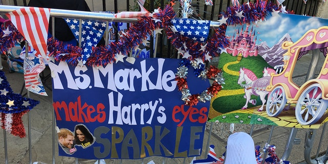 A handmade poster adorns the sidewalk and barricades outside of Windsor Castle where people are camped out ahead of the royal wedding.