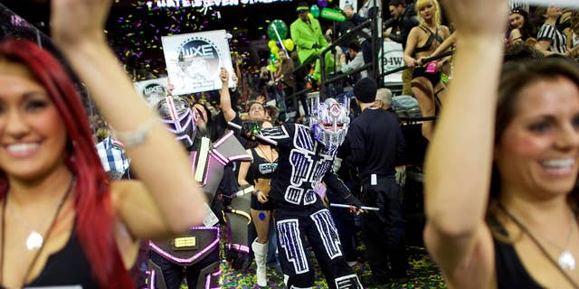 Jan. 30, 2015: Cheerleaders and characters supporting contestants parade through the Wells Fargo Center before the 23rd annual Wing Bowl in Philadelphia.