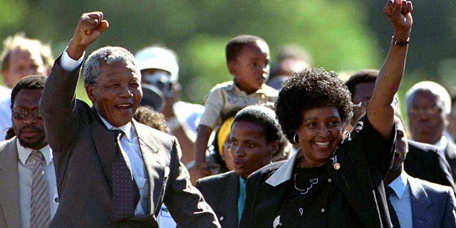 Nelson Mandela and wife Winnie, walk hand in hand, raising their clenched fists upon his release from Victor prison, Cape Town, 27 years in detention.