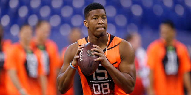 Feb. 21, 2015: Florida State quarterback Jameis Winston runs a drill at the NFL football scouting combine in Indianapolis.