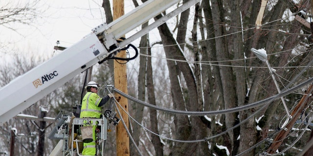 Crews work to replace utility poles in Fairless Hills, Pa. on Thursday, March 8, 2018.
