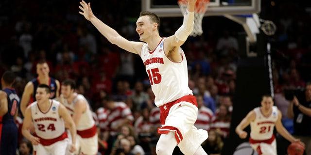 Mar. 28, 2015: Wisconsin forward Sam Dekker (15) celebrates after Wisconsin beat Arizona 85-78 in a college basketball regional final in the NCAA Tournament in Los Angeles. (AP)