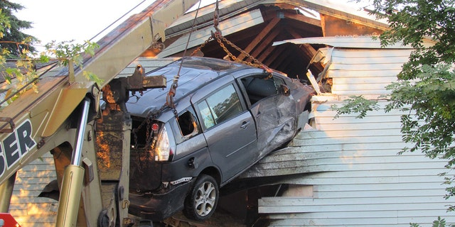 Scene after a minivan crashed into a Wisconsin home.