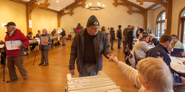 FILE: Voters at the Charles Allis Museum cast their ballots for the U.S. presidential election in Milwaukee, Wisconsin.