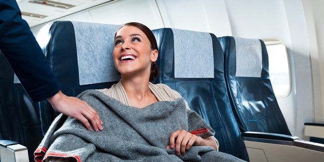 According toflight attendants, some airlines don't provide new or even clean pillows and blankets for the next round of passengers.