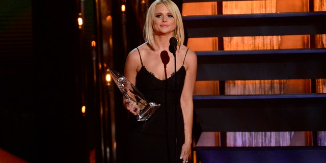 Musician Miranda Lambert accepts the Female Vocalist of the Year Award during the 48th Country Music Association Awards in Nashville, Tennessee November 5, 2014.