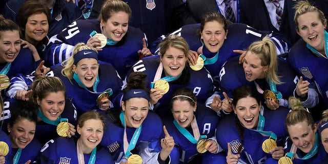 The United States hockey team celebrate with their gold medals after beating Canada in the women's gold medal hockey game at the 2018 Winter Olympics.