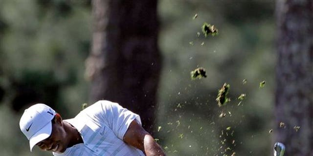 April 7, 2012: Tiger Woods hits off the first fairway during the third round of the Masters golf tournament in Augusta, Ga.