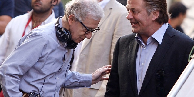 Alec Baldwin (right) has defended Woody Allen against Dylan Farrow's claims and said in January he would continue to make films with the director.