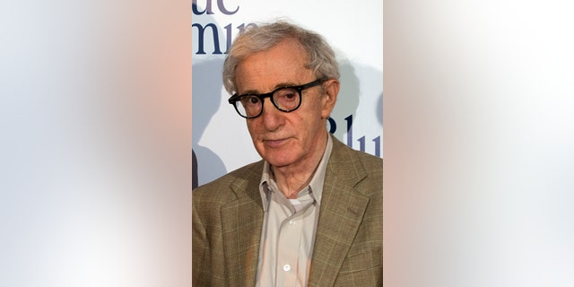 """August 27, 2013.  Woody Allen poses during the premiere of his film """"Blue Jasmine"""" in Paris."""