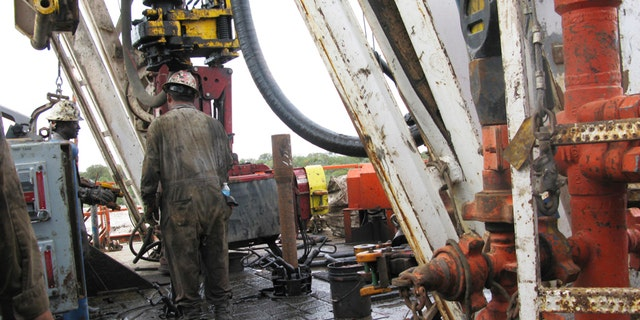 Oct. 19, 2013: Apache Corp worker drills a horizontal well in the Wolfcamp Shale in west Texas' Permian Basin.