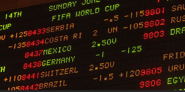 2018 World Cup odds are posted on the board at the South Point Casino's sports book in Las Vegas.