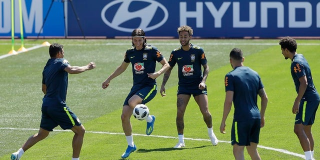 Brazil's soccer players Filipe Luis, center left, and Neymar practice with teammates during a training session in Sochi, Russia, Tuesday, June 12, 2018.