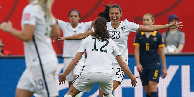 June 8, 2015: United States' Christen Press (23) celebrates her goal against Australia with Lauren Holiday (12) during a FIFA Women's World Cup soccer match in Winnipeg, Manitoba.
