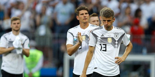 Germany's Thomas Mueller, right, reacts at the end of the group F match between Germany and Mexico at the 2018 soccer World Cup in the Luzhniki Stadium in Moscow, Russia, Sunday, June 17, 2018.