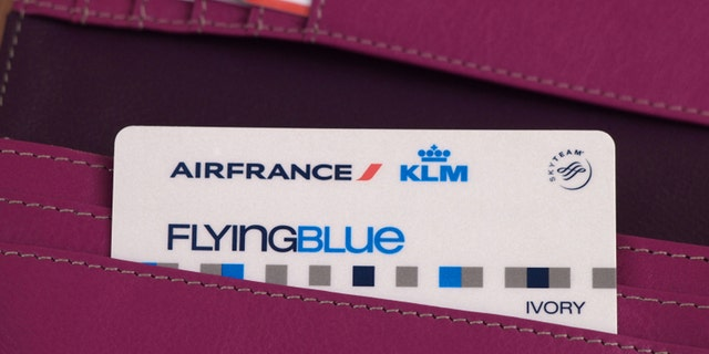 ZAGREB, CROATIA - MARCH 2, 2015: Photo of Air France - KLM card and other cards in wallet. Flying Blue, the frequent flyer program of Air France - KLM, awards members points based on miles travelled and class of service.