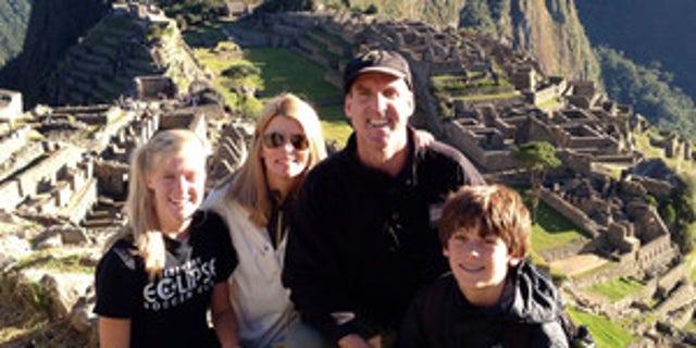 A family poses while hiking the Salkantay Trek, Machu Picchu.