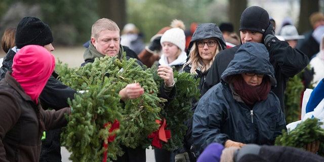 Each year, Wreaths Across America helps to place a holiday wreath on the tomb of each fallen soldier at Arlington National Cemetery in remember of U.S. veterans.