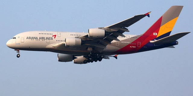 Incheon, South Korea - May 24, 2016: An Asiana Airlines Airbus A380 with the registration HL7634 approaching Seoul Incheon International Airport (ICN) in South Korea. The Airbus A380 is the world's largest passenger airliner. Asiana Airlines is an airline from South Korea with its headquarters in Seoul.