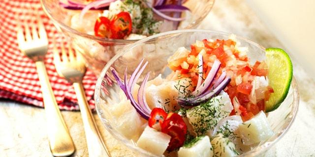 Peruvian food Ceviche. Raw fish marinated on lime juice.