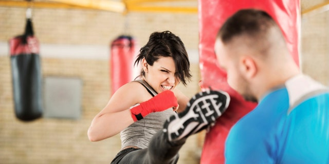 Young woman practicing boxing with her instructor. [url=http://www.istockphoto.com/search/lightbox/9786766][img]http://dl.dropbox.com/u/40117171/sport.jpg[/img][/url]
