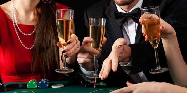 A couple of gamblers drinking a glass of champagne