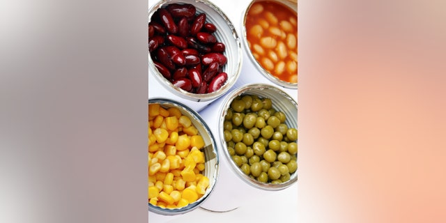 Four Open Cans of Vegetables with Corn, Green Pea, White and Red Runner Bean.