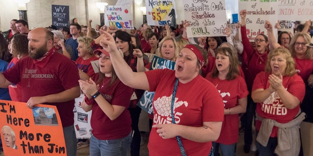 Teachers and school personnel rally at the Capitol building in Charleston on Feb. 27.