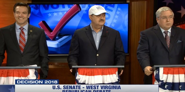 West Virginia Senate candidate wears rival's campaign hat