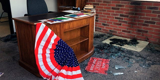 Broken glass and fire damage is shown inside the Albany County Republican Party office following a fire, Thursday, Sept. 6, 2018, in Laramie, Wyo. Authorities say the fire caused minor damage and no injuries and that it is being investigated as arson. (Shannon Broderick/Laramie Boomerang via AP)