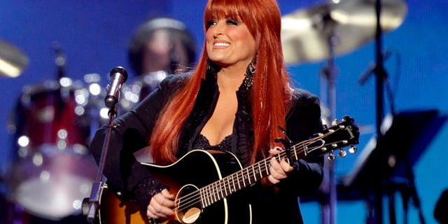 This April 4, 2011 file photo shows country winger Wynonna Judd from The Judds, performing at the Girls' Night Out: Superstar Women of Country in Las Vegas.