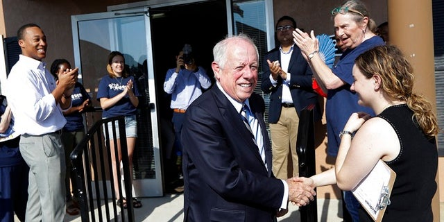Former Gov. Phil Bredesen, front center, campaigning Wednesday in Memphis, Tenn., in his bid for U.S. Senate. Bredesen and Republican U.S. Rep. Marsha Blackburn faced only nominal primary opposition in their race to replace retiring Republican Sen. Bob Corker.