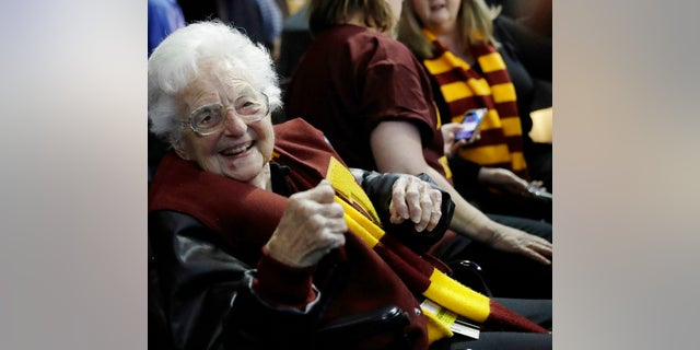 Sister Jean Dolores Schmidt sits with other Loyola-Chicago fans in Atlanta during a regional semifinal NCAA college basketball game against Nevada, March 22, 2018.
