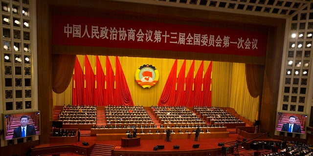Chinese President Xi Jinping is seen a large screens at the opening session of the Chinese People's Political Consultative Conference in Beijing's Great Hall of the People, March 3, 2018.