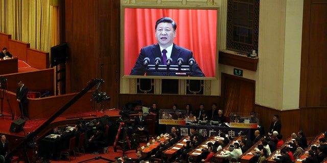 """Xi, speaking to nearly 3,000 members of the rubber-stamp National People's Congress, declared that the Chinese people were """"closer than at any time in history to realizing the great rejuvenation of the Chinese nation."""""""