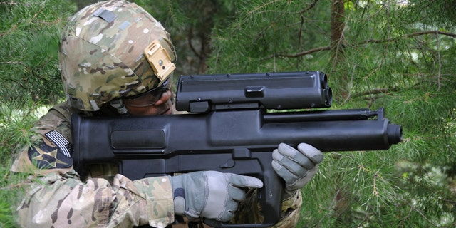 The XM25, designed by Minnesota's Alliant Techsystems, has been in development for about seven years and the first prototypes have been doled out to combat units in Afghanistan earlier this month. The 12-pound, 29-inch system, which costs up to $35,000 per unit, is so sophisticated that soldiers are proficient users literally within minutes.  (U.S. Army)