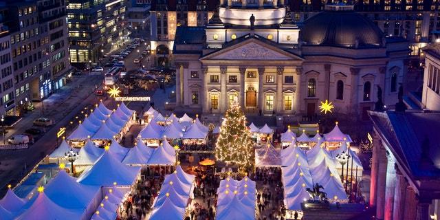 christmas market on berlin gendarmenmarkt at night