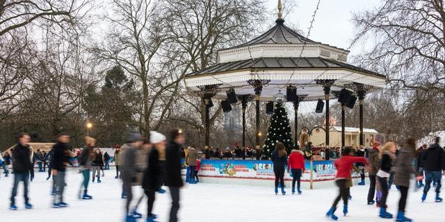 LONDON, UK - DECEMBER 13, 2012: People ice skate at the Winter Wonderland ice rink in Hyde Park.