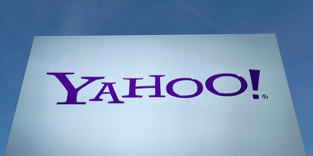 File photo: Feb. 7, 2014: Yahoo logo is pictured in front of a building in Rolle, 19 miles east of Geneva.