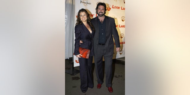 Yasmine Bleeth and partner Paul Cerrito at a party to celebrate the engagement of Carmen Electra to Dave Navarro at the Pacific Design centre in Los Angeles, CA in 2006.