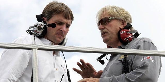 Robert Yates, left, talks to Doug Yates at New Hampshire Motor Speedway in 2006