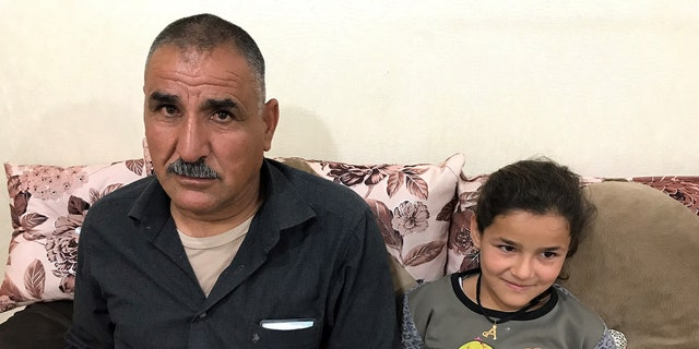 Enas, 5 - a young Yazidi recently rescued from Turkey - and her Uncle Hassam