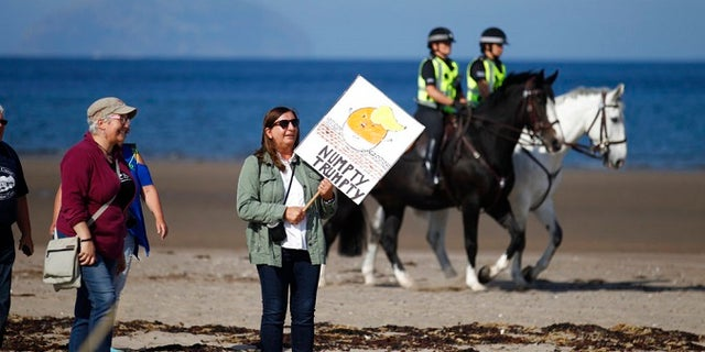 Police on horseback provide security at the Trump Turnberry golf resort in western Scotland.
