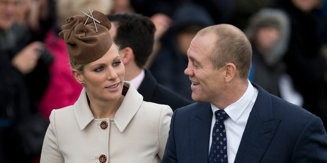 This is a Tuesday, Dec. 25, 2012 file photo of Britain's Queen Elizabeth II's granddaughter Zara Phillips and her husband rugby player Mike Tindall. Buckingham Palace said Phillips and Tindall are expecting their first child in the new year.