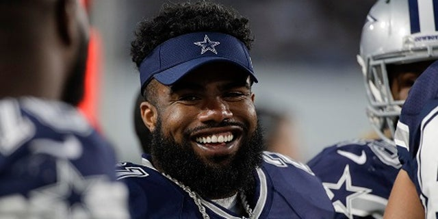 Dallas Cowboys running back Ezekiel Elliott looks on from the sidelines during the second half of a preseason NFL football game against the Los Angeles Rams Saturday, Aug. 12, 2017, in Los Angeles. (AP Photo/Jae C. Hong)