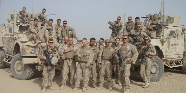 Members of Slivka's platoon are pictured with Zia in Afghanistan