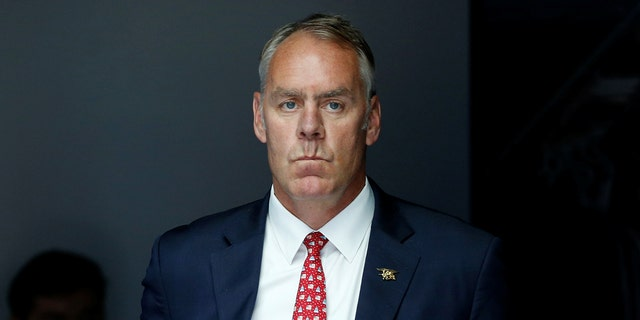 U.S. Interior Secretary Ryan Zinke waits to take the stage with President Donald Trump for his on infrastructure improvements, at the Department of Transportation in Washington, U.S. June 9, 2017.  REUTERS/Jonathan Ernst - RC1BC3DF4610