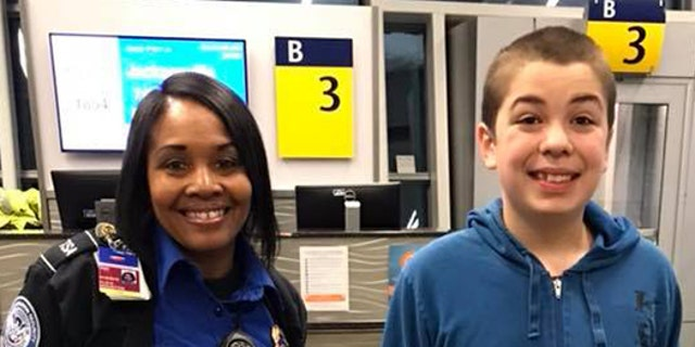 The TSA employee, Alesea, is seen posing with 13-year-old Zion in front of his gate at the Indianapolis International Airport.