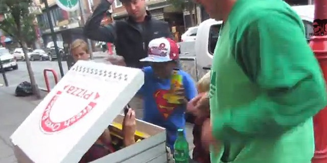A team of pranksters scared the pepperoni out of people thinking they were getting a free slice of pizza.